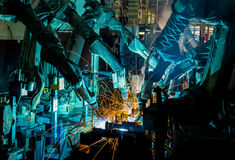 Welding Robot movement in a car factory Stock Photography