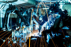 Welding Robot movement in a car factory Stock Image