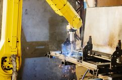 Welding robot in operation. Photo taken in Russia, in factory premises Stock Photos