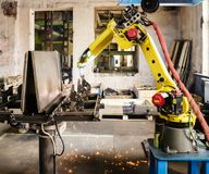 Welding robot in operation. Photo taken in Russia, in factory premises Royalty Free Stock Photos