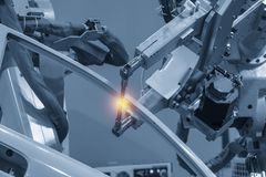 The welding robotic machine welding the automotive parts . The welding robotic machine welding the automotive parts with lighting effect. Industrial 4.0 concept royalty free stock image