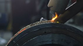 Close up of welding robots apply overlay weld protection on the pipe disks. Automatic welding of pipe-rolling stock footage
