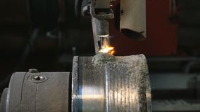 Welding robots apply overlay weld protection on the pipe disks. Automatic welding of pipe-rolling stock footage