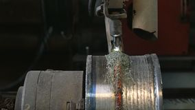 Welding robots apply overlay weld protection on the pipe disks. Automatic welding of pipe-rolling stock video footage