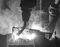 Welding robots movement, Black & White. Welding robots movement in a car factory Royalty Free Stock Image