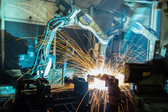 Welding robots movement in a car factory royalty free stock photo