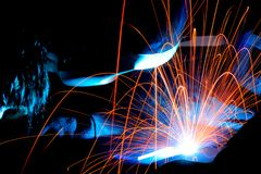 Welding sparks. Sparks while welder uses torch to welding Royalty Free Stock Photography