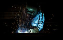 Welding with sparks. In manufracturing process Royalty Free Stock Photos