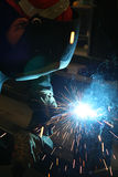 Welding sparks. Blue welding sparks and smoke during welding Stock Images