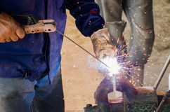 Welding with sparks. Welding and bright sparks. Hard job Stock Photography