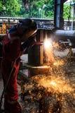 Welding. Sparks of welders in the industry Stock Photos