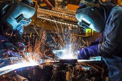 Welding with sparks. Worker with protective mask welding metal Royalty Free Stock Photo