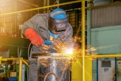 Welding steel for construction. Worker welding steel pipe for construction by using arc welder and wear equipment protection for safety Royalty Free Stock Photos