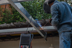 Welding steel by the male worker in industrial metal steel.  Stock Images