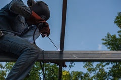 Welding steel by the male worker in industrial metal steel.  Royalty Free Stock Photography