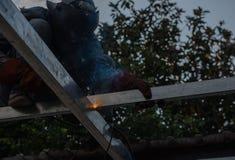 Welding steel by the male worker in industrial metal steel.  Stock Photography