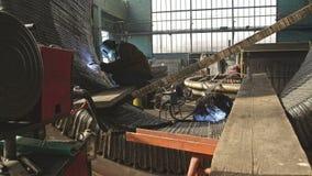 Welding a steel pipes. Gas tungsten arc welding stock footage