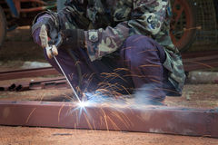 Welding steel. With sparks lighting Stock Photos