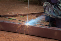 Welding steel. With sparks lighting Royalty Free Stock Photo