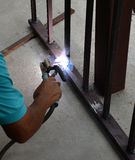 Welding steel with sparks Royalty Free Stock Photo