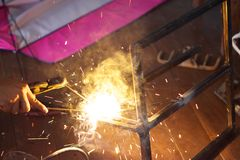 Welding steel with spread spark and lighting around Stock Photos