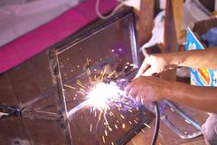 Welding steel with spread spark and lighting around Stock Images