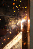 Welding steel with spread spark lighting smoke Stock Images