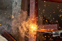 Welding steel with spread spark lighting smoke Royalty Free Stock Photography