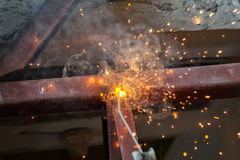 Welding steel with spread spark lighting smoke Stock Photos