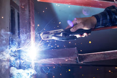 Welding steel with spread spark lighting smoke Royalty Free Stock Images