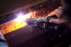 Welding steel with spread spark lighting smoke Stock Image