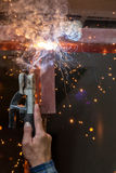 Welding steel with spread spark lighting smoke Stock Photo