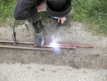Welding of steel square pipe electric welding. The use of electric welding in the home Stock Image