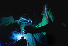 Welding steel structures and bright sparks in steel construction Royalty Free Stock Photos