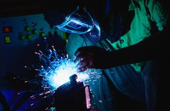 Welding steel structures and bright sparks in steel construction Royalty Free Stock Photo