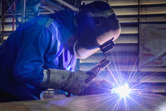 Welding steel structures and bright sparks Royalty Free Stock Images