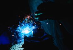 Welding steel structures and bright sparks in steel construction Stock Photo