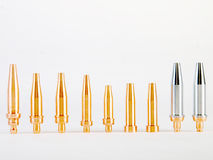 Welding Torch Tips. Set of bronze and stainless steel tips for a welding torch stock image