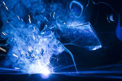 Welding using MIG/MAG. Welding steel pieces in company using MIG/MAG Stock Photo
