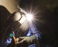 Welding work. Welder at work in hot and dirty work Royalty Free Stock Images
