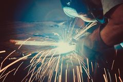 Welding Work. Erecting Technical Steel Industrial Steel Welder In Factory Royalty Free Stock Image