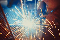 Welding Work. Erecting Technical Steel Industrial Steel Welder In Factory Stock Photography