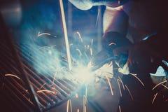 Welding Work. Erecting Technical Steel Industrial Steel Welder In Factory Royalty Free Stock Photos