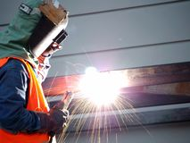 Welding work, worker with protective welding stock photography