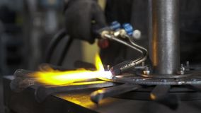 Welding, Worked as a welder. closeups of welding equipment, sparks fly, smoke and fire. molten metal. Slow motion stock footage