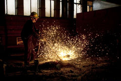 Welding worker. With hot sparks Stock Images
