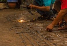 The welding worker Stock Photos