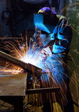Welding worker in dark facotry Stock Photo