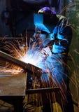 Welding worker in dark facotry Stock Photo