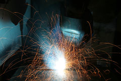 Welding worker in factory Royalty Free Stock Photography